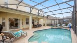 Brentwood 1 Villa rental near Disney with The view of the covered lanai, lounge chairs & basketball hoop from the spa