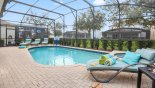 Your private screened in, heated in-ground pool and spa with oversized pool deck from Brentwood 1 Villa for rent in Orlando