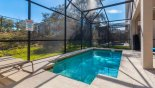 Pool deck with 2 sun loungers from Majesty Palm 2 Villa for rent in Orlando