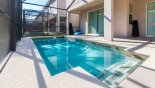 Villa rentals in Orlando, check out the View of pool towards covered lanai - note stowed pool safety fence