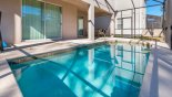 View of pool from covered lanai with patio furniture - www.iwantavilla.com is your first choice of Villa rentals in Orlando direct with owner