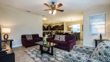 Family room with flat screen TV & DVD player - www.iwantavilla.com is the best in Orlando vacation Villa rentals