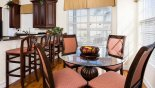Breakfast nook seating 4 with great views onto pool deck - www.iwantavilla.com is the best in Orlando vacation Villa rentals