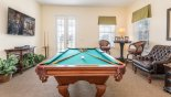 Upstairs games room with pool table & wall mounted Smart TV from Homestead 1 Villa for rent in Orlando