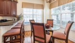 Breakfast nook seating 4 with great views onto pool deck from Homestead 1 Villa for rent in Orlando