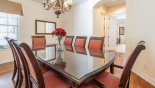 Formal dining area with table & 8 chairs - www.iwantavilla.com is your first choice of Villa rentals in Orlando direct with owner