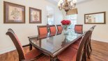 Formal dining room with large dining table with seating for 8 persons - www.iwantavilla.com is the best in Orlando vacation Villa rentals