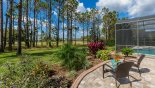 Villa rentals in Orlando, check out the Separate patio area outside the pool cage