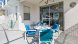 Covered lanai with patio table & 4 chairs plus ceiling fan - www.iwantavilla.com is your first choice of Villa rentals in Orlando direct with owner