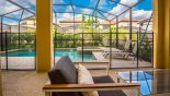 View from covered lanai onto pool with this Orlando Villa for rent direct from owner