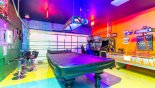 Games room with pool table, air hockey, table foosball, pinball game and 3 arcade games - www.iwantavilla.com is the best in Orlando vacation Villa rentals