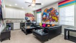 Loft area with comfortable sofas, bar area and large HDTV from Solterra Resort rental Villa direct from owner