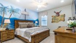 Pirate themed ensuite bedroom 5 with king sized bed and wall mounted LCD TV from Versailles 1 Villa for rent in Orlando