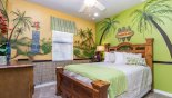 Villa rentals in Orlando, check out the Bedroom 4 with queen sized bed and Tiki jungle theming