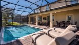 Pool deck with 3 comfortable sun loungers - www.iwantavilla.com is the best in Orlando vacation Villa rentals