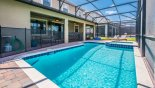 View of pool showing pool safety fence erected with this Orlando Villa for rent direct from owner