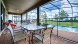 Covered lanai with patio table & 6 chairs - also 4 sun loungers & gas BBQ are also provided - www.iwantavilla.com is the best in Orlando vacation Villa rentals