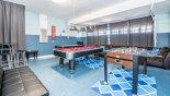 Games room with pool table, air hockey and table foosball from Champions Gate rental Villa direct from owner