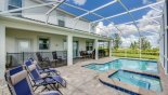 Villa rentals in Orlando, check out the Pool deck viewed towards covered lanai - 5 sun loungers