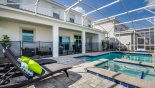 Cayman 1 Villa rental near Disney with Pool deck viewed towards covered lanai