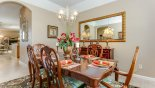 Dining room with arched direct access to kitchen from Highlands Reserve rental Villa direct from owner