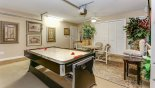Villa rentals in Orlando, check out the Games room with pool table converted to an air hockey table