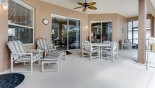 Covered lanai with patio table & 4 chairs plus additional reclining chairs with footstools from Wellesley 4 Villa for rent in Orlando