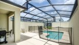 Pool deck with pool safety fence & gas BBQ - www.iwantavilla.com is your first choice of Townhouse rentals in Orlando direct with owner