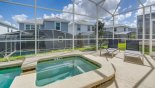 2 comfortable sun beds overlooking pool and spa from Alexander Palm 3 Villa for rent in Orlando