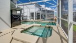 Villa rentals in Orlando, check out the Pool and spill over spa looking towards covered lanai area