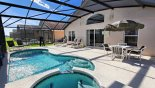 Villa rentals in Orlando, check out the Pool deck with patio table, parasol & 4 chairs - note pool safety fence stowed