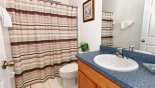 Downstairs family bathroom adjacent to queen bedroom with bath & shower over from St Kitts 1 Villa for rent in Orlando