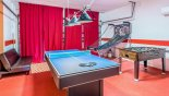 Games room with pool table/table tennis, table foosball & basketball game - www.iwantavilla.com is your first choice of Villa rentals in Orlando direct with owner