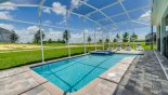 Sunny north-west facing pool deck with 4 sun loungers from Champions Gate rental Villa direct from owner