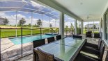 Covered lanai with patio table & 8 chairs from Champions Gate rental Villa direct from owner
