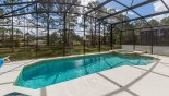 South east facing pool & spa with pond views through trees from Watersong Resort rental Villa direct from owner