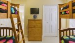 Bedroom #4 with wall mounted LCD cable TV with this Orlando Villa for rent direct from owner