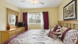 Bedroom #2 with LCD cable TV & views over pool deck with this Orlando Villa for rent direct from owner
