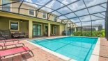 View of pool towards covered lanai showing partially erected pool safety fence from Fiji 2 Villa for rent in Orlando