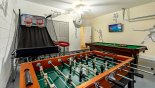 Games room with pool table, table foosball, basketball game & wall mounted LCD Roku enabled TV from Winchester 1 Villa for rent in Orlando