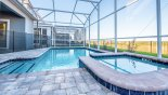 Spacious rental Champions Gate Villa in Orlando complete with stunning View of pool area  looking towards villa
