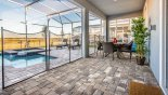 Outdoor dining area overlooking pool with seating for 6 people from Fiji 6 Villa for rent in Orlando