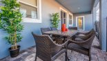 Villa rentals in Orlando, check out the Comfortable seating area on pool deck for 6 people under covered lanai