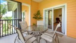 Balcony outside master bedroom with round table & 5 chairs with this Orlando Condo for rent direct from owner