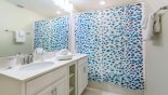 Orlando Condo for rent direct from owner, check out the Bathroom 2 with his & hers sinks and bath over shower