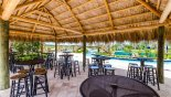 Tiki bar with seating area - www.iwantavilla.com is the best in Orlando vacation Condo rentals