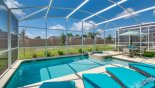 Spacious rental Champions Gate Villa in Orlando complete with stunning Sunny pool deck with large pool & spa plus 4 sun loungers for your sunbathing comfort