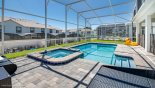 Villa rentals in Orlando, check out the Covered east facing pool complete with toddler safety guard