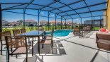 Spacious rental Solterra Resort Villa in Orlando complete with stunning Complete view of pool deck with seating area for 8 people and 4 sun loungers
