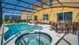 Villa rentals in Orlando, check out the Pool with spa next to outdoor seating area for 8 people